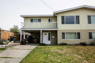 Photo 1: 7590 DAVIES Street in Burnaby: Edmonds BE 1/2 Duplex for sale (Burnaby East)  : MLS®# R2107790