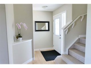 Photo 3: 772 LUXSTONE Landing SW: Airdrie House for sale : MLS®# C4016201