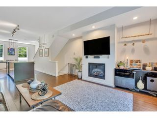 """Photo 1: 44 101 FRASER Street in Port Moody: Port Moody Centre Townhouse for sale in """"CORBEAU by MOSAIC"""" : MLS®# R2597138"""