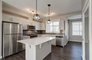 Photo 9: 103 Walgrove Cove SE in Calgary: Walden Row/Townhouse for sale : MLS®# A1145152
