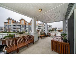 "Photo 19: 204 6470 194 Street in Surrey: Clayton Condo for sale in ""WATERSTONE-ESPLANADE"" (Cloverdale)  : MLS®# R2427138"