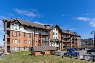 Photo 2: 2407 15 SUNSET Square: Cochrane Apartment for sale : MLS®# A1072593