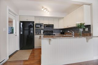 """Photo 15: 34906 2ND Avenue in Abbotsford: Poplar House for sale in """"Huntindgon Village"""" : MLS®# R2102845"""