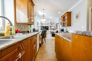 Photo 13: 7779 146A Street in Surrey: East Newton House for sale : MLS®# R2585816