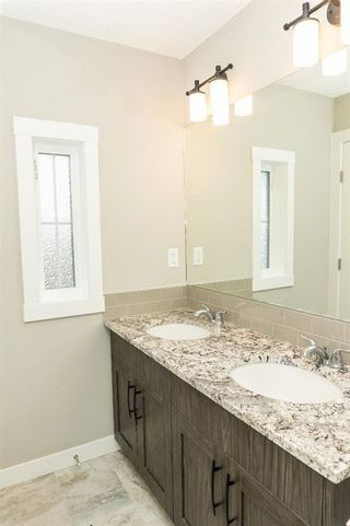 Photo 18: 166 Howse Common in Calgary: Livingston Detached for sale : MLS®# A1143791