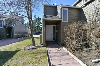 Photo 2: 1301 829 Coach Bluff Crescent in Calgary: Coach Hill Row/Townhouse for sale : MLS®# A1094909
