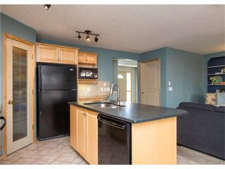 Photo 8: 150 BRIDLECREEK Park SW in Calgary: Bridlewood House for sale : MLS®# C4086800