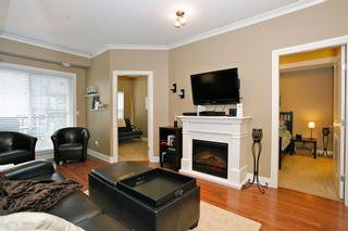 "Photo 6: 204 20286 53A Avenue in Langley: Langley City Condo for sale in ""Casa Verona"" : MLS®# F1428977"
