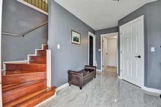 Photo 3: 1729 WARWICK AVENUE in Port Coquitlam: Central Pt Coquitlam House for sale : MLS®# R2577064