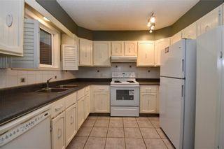 Photo 4: 16 CASTLEGROVE Place NE in Calgary: Castleridge Detached for sale : MLS®# C4208662