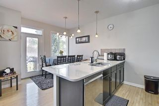 Photo 7: 6 Everridge Gardens SW in Calgary: Evergreen Row/Townhouse for sale : MLS®# A1145824