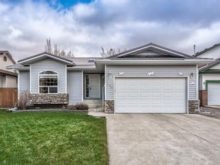 Photo 1: 106 Highwood Village Place NW: High River Detached for sale : MLS®# A1095860