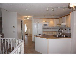 Photo 8: 208 TARINGTON Close NE in Calgary: Taradale House for sale : MLS®# C4040082
