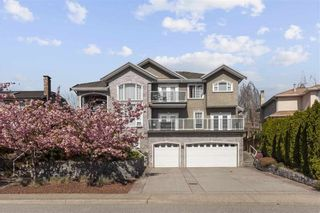 Photo 1: 2265 LECLAIR Drive in Coquitlam: Coquitlam East House for sale : MLS®# R2572094