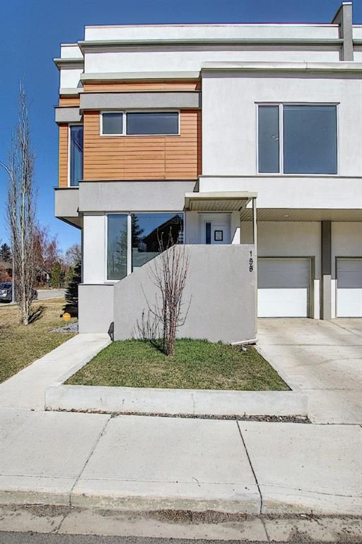 Main Photo: 158 23 Avenue NW in Calgary: Tuxedo Park Row/Townhouse for sale : MLS®# A1094441