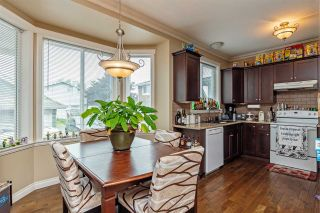 """Photo 12: 34745 3RD Avenue in Abbotsford: Poplar House for sale in """"HUNTINGDON VILLAGE"""" : MLS®# R2580704"""