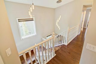 Photo 19: 28 Cougar Ridge Place SW in Calgary: Cougar Ridge Detached for sale : MLS®# A1154068
