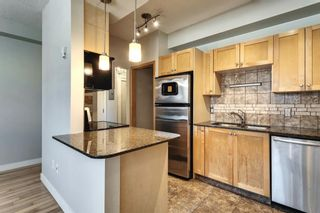 Photo 2: 1 1715 13 Street SW in Calgary: Lower Mount Royal Apartment for sale : MLS®# A1082017