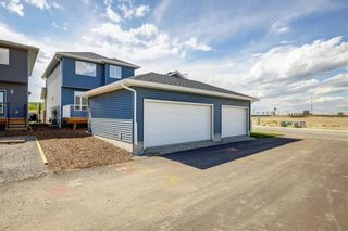 Photo 33: 112 Creekside Drive SW in Calgary: C-168 Semi Detached for sale : MLS®# A1060918