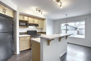 Photo 7: 157 Eversyde Boulevard SW in Calgary: Evergreen Semi Detached for sale : MLS®# A1055138