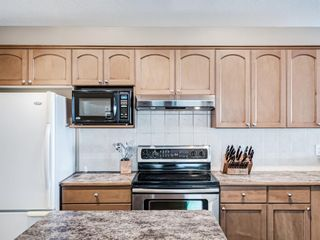Photo 15: 57 Brightondale Parade SE in Calgary: New Brighton Detached for sale : MLS®# A1057085