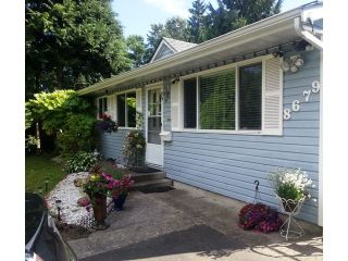 Photo 2: 8679 TULSY Crescent in Surrey: Queen Mary Park Surrey House for sale : MLS®# F1448381