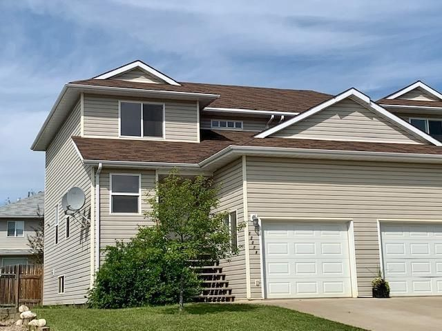 """Main Photo: A 5207 HALLMARK Crescent in Fort Nelson: Fort Nelson -Town 1/2 Duplex for sale in """"MIDTOWN"""" (Fort Nelson (Zone 64))  : MLS®# R2515572"""