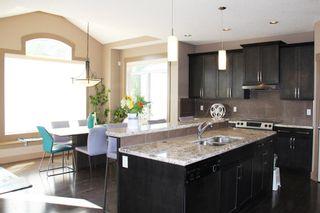 Photo 4: 47 ASPEN STONE Manor SW in Calgary: Aspen Woods Detached for sale : MLS®# A1028178