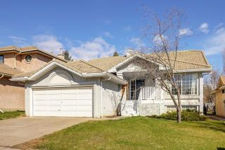 Photo 1: 24 SIGNATURE Way SW in Calgary: Signal Hill Detached for sale : MLS®# C4302567