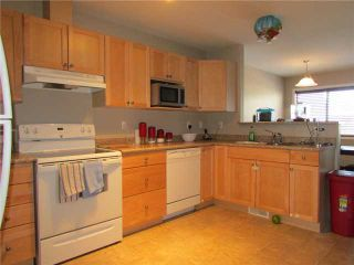 """Photo 2: 7916 97TH Avenue in Fort St. John: Fort St. John - City SE 1/2 Duplex for sale in """"NORTH ANNEOFIELD"""" (Fort St. John (Zone 60))  : MLS®# N234446"""