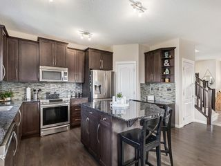 Photo 11: 116 HEARTLAND Way: Cochrane Detached for sale : MLS®# C4305625