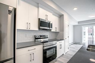 Main Photo: 310 200 Harvest Hills Place in Calgary: Harvest Hills Apartment for sale : MLS®# A1144759