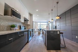 Photo 4: 105 1632 20 Avenue NW in Calgary: Capitol Hill Row/Townhouse for sale : MLS®# A1068096