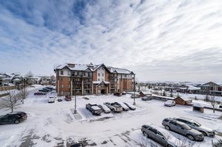Photo 1: 2310 15 Sunset Square: Cochrane Apartment for sale : MLS®# A1069637