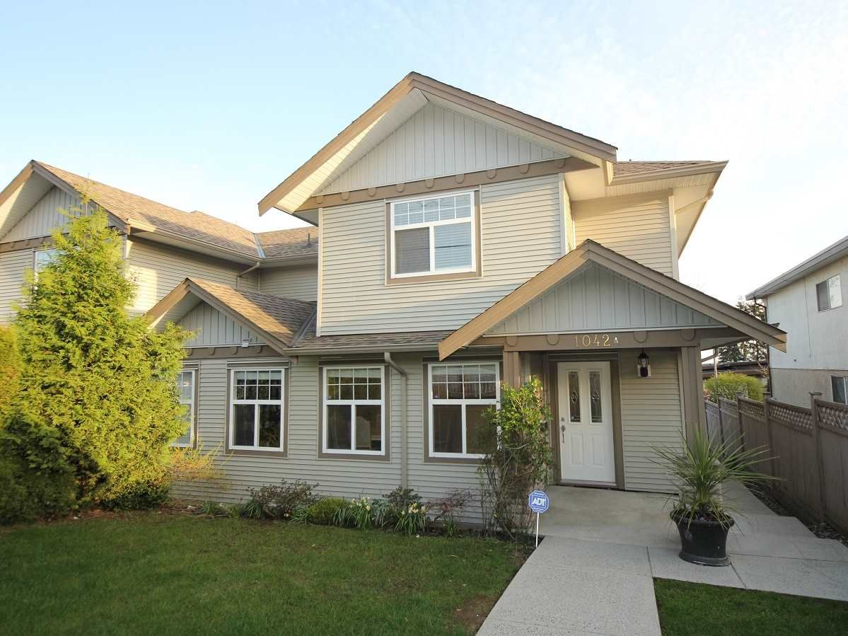 Main Photo: A 1042 CHARLAND Avenue in Coquitlam: Central Coquitlam 1/2 Duplex for sale : MLS®# R2257385