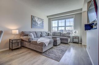 Photo 10: 100 Legacy Main Street SE in Calgary: Legacy Row/Townhouse for sale : MLS®# A1095155