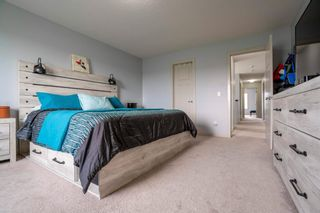 Photo 13: 70 Everhollow Green SW in Calgary: Evergreen Detached for sale : MLS®# A1131033