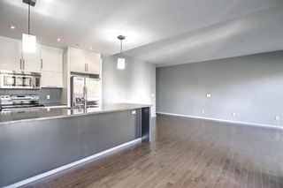 Photo 11: 207 414 Meredith Road NE in Calgary: Crescent Heights Apartment for sale : MLS®# A1150202