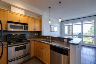 Photo 14: 6 133 Rockyledge View NW in Calgary: Rocky Ridge Apartment for sale : MLS®# A1147777