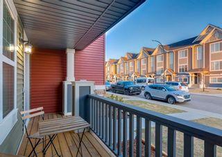 Photo 2: 40 EVANSRIDGE Court NW in Calgary: Evanston Row/Townhouse for sale : MLS®# A1095762
