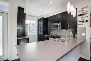 Photo 6: 25 Nolan Hill Boulevard NW in Calgary: Nolan Hill Row/Townhouse for sale : MLS®# A1073850