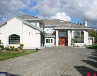 Photo 1: 5858 126A ST in Surrey: Panorama Ridge House for sale : MLS®# F2605438
