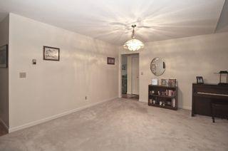 "Photo 6: 221 7156 121 Street in Surrey: West Newton Townhouse for sale in ""Glenwood Village"" : MLS®# R2215838"