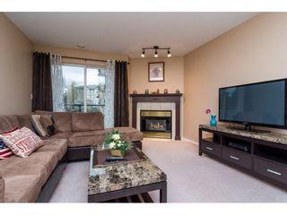 "Photo 4: 206 20277 53 Avenue in Langley: Langley City Condo for sale in ""Metro 11"" : MLS®# R2246436"