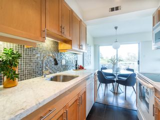 """Photo 16: 401 5926 TISDALL Street in Vancouver: Oakridge VW Condo for sale in """"OAKMONT PLAZA"""" (Vancouver West)  : MLS®# R2374156"""