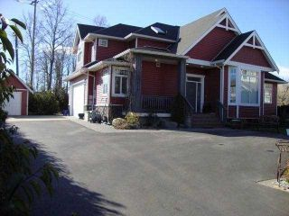 """Photo 1: 34814 1ST Avenue in Abbotsford: Poplar House for sale in """"Huntingdon"""" : MLS®# F1405409"""