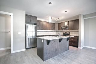 Photo 2: 555 Redstone View NE in Calgary: Redstone Row/Townhouse for sale : MLS®# A1149779