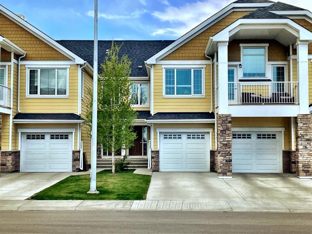 Main Photo: 403 2400 Ravenswood View SE: Airdrie Row/Townhouse for sale : MLS®# A1111114