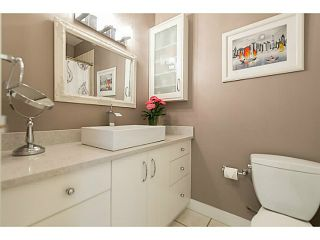 """Photo 12: 214 1345 W 15TH Avenue in Vancouver: Fairview VW Condo for sale in """"SUNRISE WEST"""" (Vancouver West)  : MLS®# V1118182"""