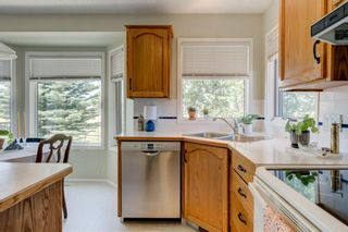 Photo 10: 128 Shawinigan Way SW in Calgary: Shawnessy Detached for sale : MLS®# A1125201